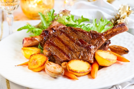 Veal chop with vegetables for Christmas dinner Stock Photo - 22636380