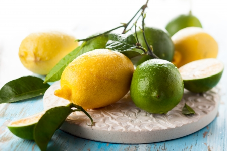 fresh lime and lemon with leaves