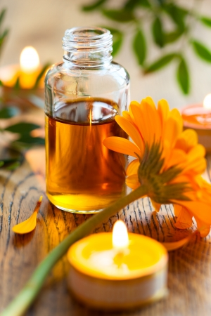 traquility: bottles of essential oil,candles and flowers Stock Photo