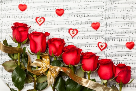 Red roses  over  background with musical notes for Valentine photo