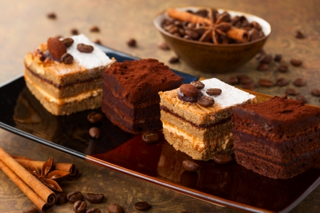 Coffee cream  small cakes and chocolate truffle cakes photo