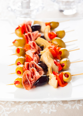 antipasti: Antipasti skewers with olives,red pepper,artichoke hearts and salami