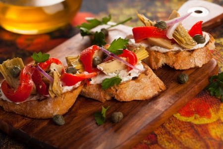 bruschetta: Artichoke toasts with grilled red pepper Stock Photo