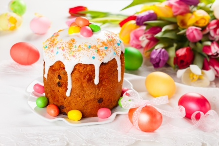 Easter cake and  eggs on festive Easter table Stock Photo