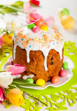 Easter cake and  eggs on festive Easter table photo