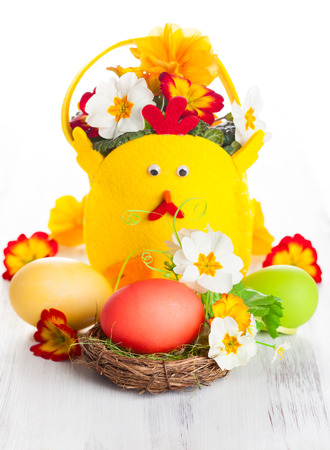 Easter table decoration with flowers and eggs photo