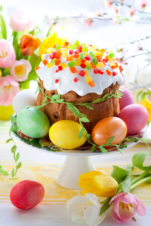 Easter cake and colourful eggs on festive Easter table photo