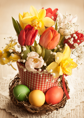 Vintage Bouquet of spring flowers and easter eggs for Easter photo