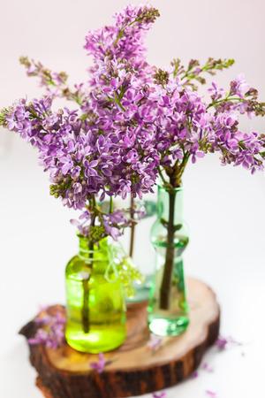 floral arrangements: bouquet of violet lilac in a vase