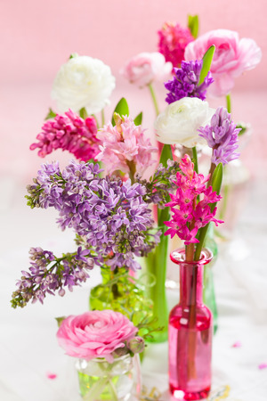 Beautiful spring flowers in vases photo