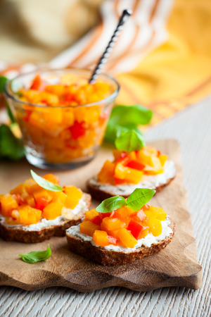 toast with pumpkin and red bell pepper chutney photo
