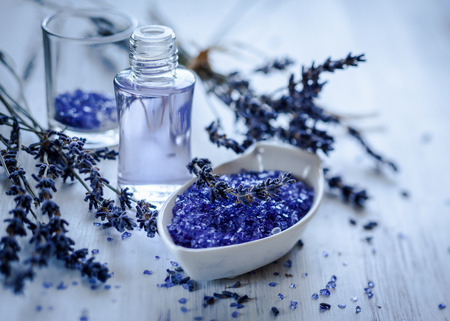 Dried lavender flowers with a bottle of essential oil and salt,toned