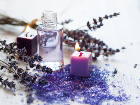 Dried lavender flowers with a bottle of essential oil Stok Fotoğraf
