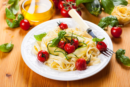 Tagliatelle with cherry tomatoes and zucchini photo