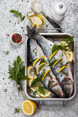 sea bass: Sea bass with lemon,herbs and persian blue salt before cooking