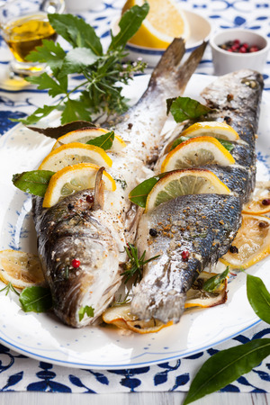 sea bass: Oven-baked Sea bass with lemon and herbs