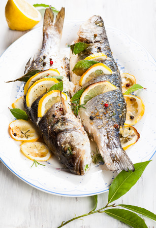 ovenbaked: Oven-baked Sea bass with lemon and herbs