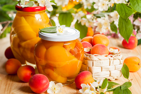 Jars of apricot and peach preserves photo
