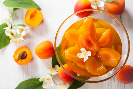 Peach flower: Fresh apricot compote in glass bowl
