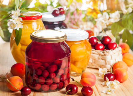 Jars of homemade fruit preserves photo