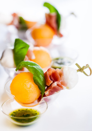 holiday catering: Appetizer with melon,mozzarella and prosciutto on skewers
