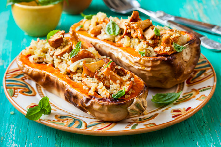 chanterelle: Stuffed butternut squash with quinoa and mushrooms Stock Photo