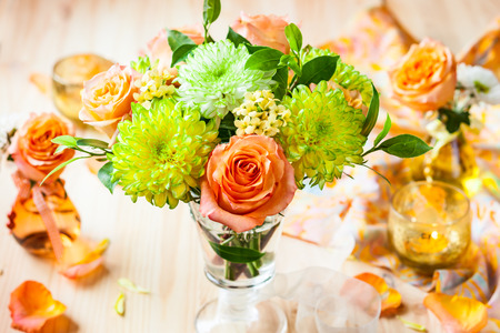 Still life with  bunch of autumn flowers and roses photo