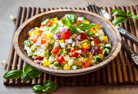 Quinoa salad with cucumber,tomato and feta photo