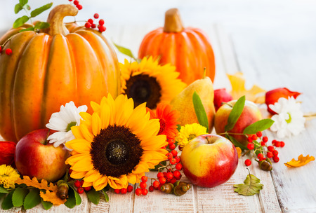 Autumn still life with seasonal fruits,vegetables and flowers