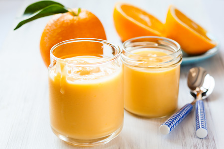 curd: Homemade orange curd in a jar