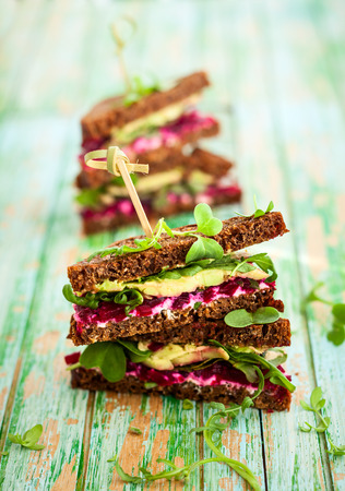 sandwich with beet,cheese,avocado and arugula Imagens