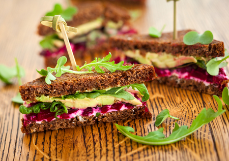 wholemeal: sandwich with beet,cheese,avocado and arugula Stock Photo