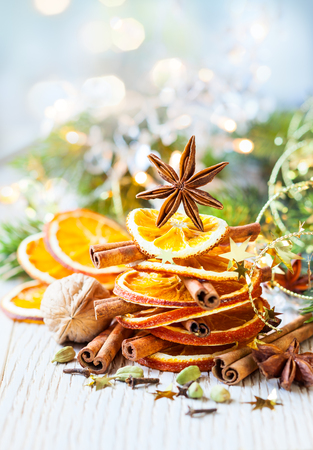 Christmas tree made out of dried oranges,cinnamon sticks and anise star photo