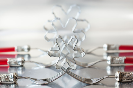 Christmas place setting with snowflake cookie cutter photo