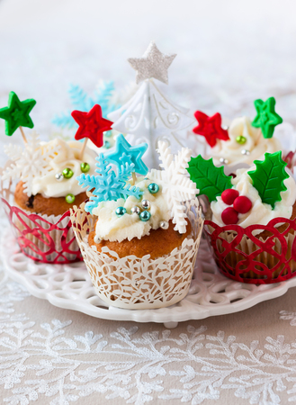 Festive Christmas cupcakes with vanilla frosting and sugar decoration photo