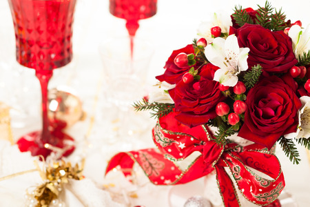 Christmas table decoration with festive bouquet photo