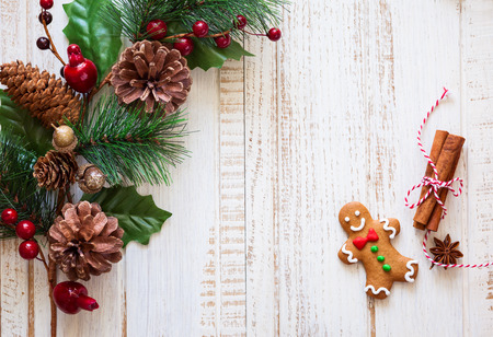 star border: Christmas background with gingerbread,fir  branches and spices on the old wooden board