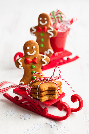 Gingerbread men cookies in a sledge photo