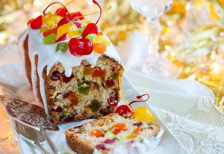fruitcake: Christmas fruitcake with sugar icing and candied fruits Stock Photo