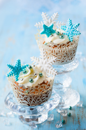 Festive Christmas cupcakes decorated with sugar snowflakes photo