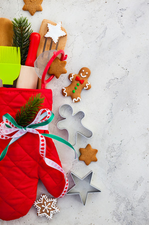 christmas wrapping: Christmas gift wrapping idea  with oven mitt,kitchen utensils and cookies Stock Photo