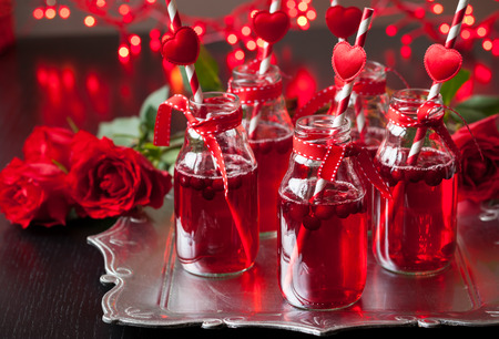 cocktail drinks: Valentines Day party idea:individual small bottles with cranberry cocktail