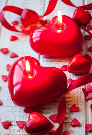 flame like: Heart shaped candles and sweet candy for Valentine