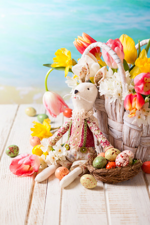 Easter bunny,spring flowers and chocolate eggs photo