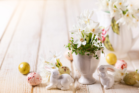 Easter decoration with spring flowers,chocolate eggs and rabbits photo