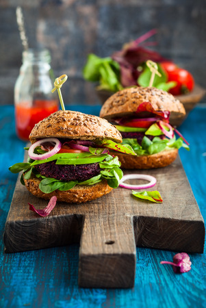 Veggie beet and quinoa burger with avocado photo