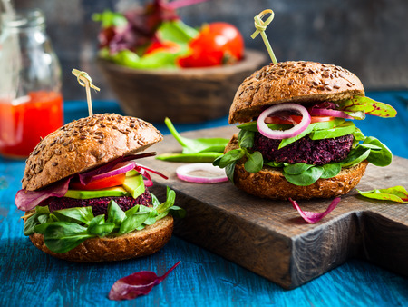 red quinoa: Veggie beet and quinoa burger with avocado Stock Photo