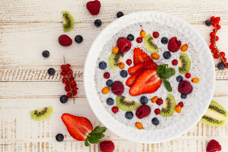chia: Breakfast bowl: coconut chia pudding with fruits and berries.