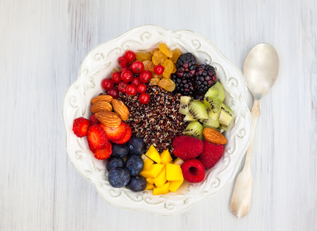 Honey black quinoa with fruits,berries and nut for breakfast Фото со стока
