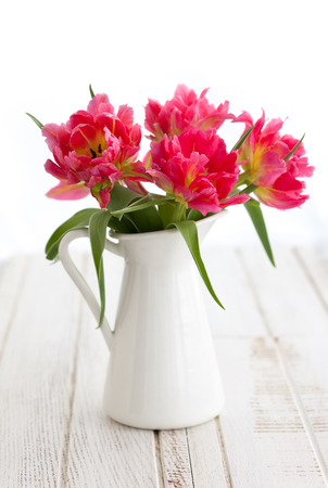 paschal: Beautiful pink double peony tulip in vase on the wooden table
